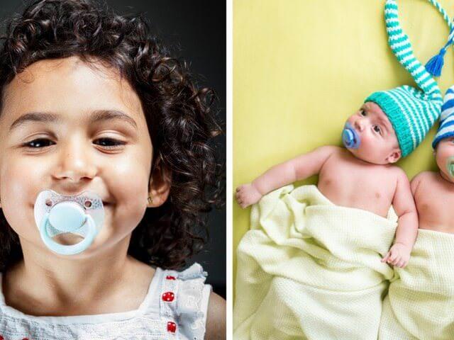 Дети с пустышками во рту